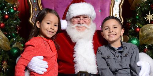 kids sitting with Santa