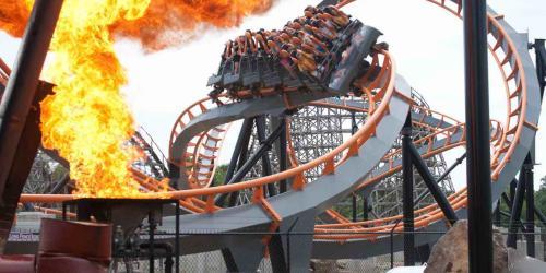Rides face flames of Apocalypse Coaster