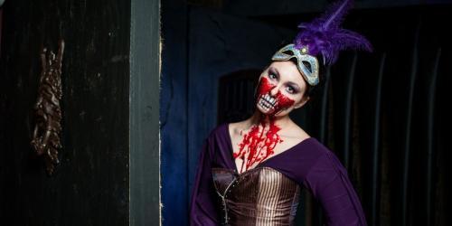 The Voodoo Queen smiles at her next victim.