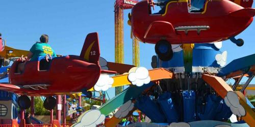 Guests riding in ZoomJets red planes