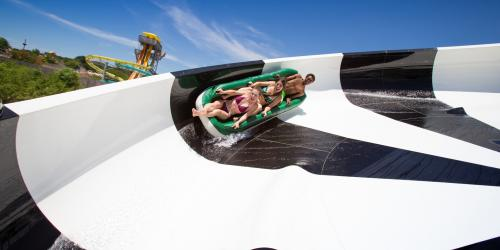 Three friends in raft on Tsunami Surge