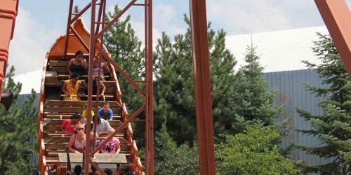 River Rocker full of guests swinging mid-air