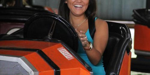 Woman riding Rue le Dodge orange bumper car