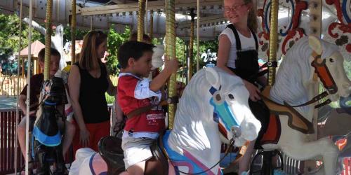 Smiling kids on Carousel