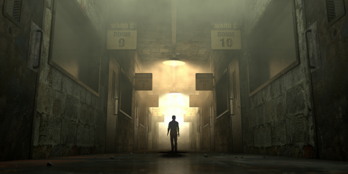 Man stands alone is an eerie hallway