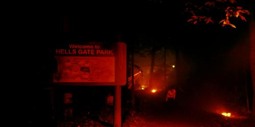Zombie lurking in The Aftermath: Zombies Revenge during Fright Fest at Six Flags New England