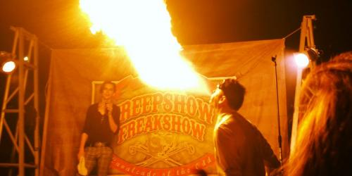 Man breathing fire during Fright Fest at Six Flags New England