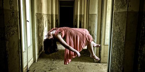 Victim levitating at abandoned warehouse