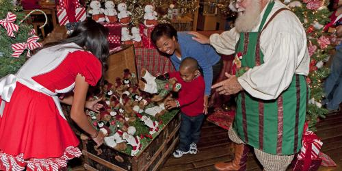 Mother and Son shopping with Santa and Santa Helper