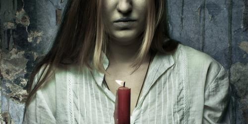 Creepy girl holding a candle.