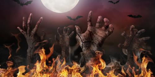 Zombie hands reaching up out of fire