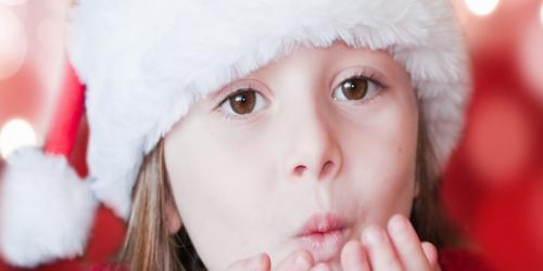 Girl in a Santa hat.