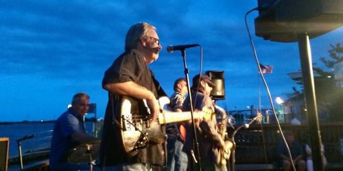 Sonny Kenn band playing guitar