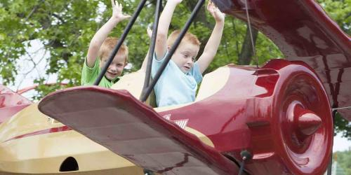 Two children ride the Bugs Bunny Ranger Pilots kids ride