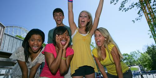 Excited Teens at Theme Park