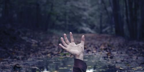 Hand appearing out of the ground in the Wicked Woods at The Great Escape.