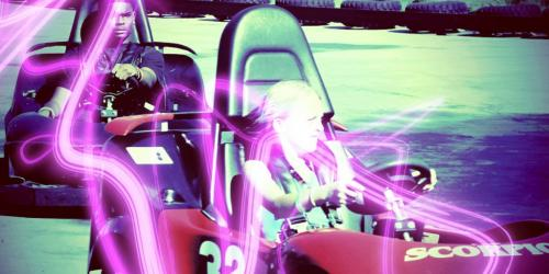 Teens driving go-karts