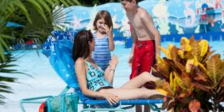 parent and kids lounging at wave pool