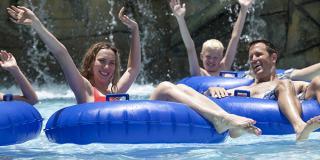 Family floating in inner tubes