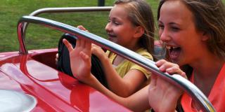 Kids having fun driving a car.