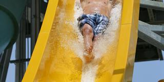 guest riding water slide