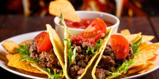 Tacos and chips on a plate