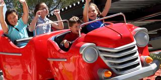 children enjoying kid coaster