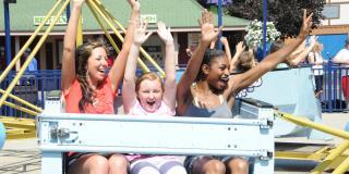 kids riding scrambler at the park