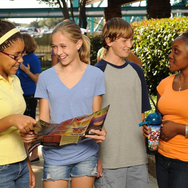 group of kids looking at map