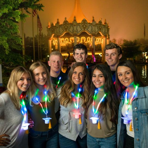 Grad Nite visitors wearing their Grad Nite gift necklaces outside the Carousel