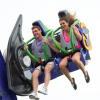 Couple in car of THE JOKER: Free Fly Coaster mid air smiling