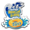 Hurricane harbor logo with tube, water, and 2019