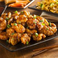 orange chicken and chopsticks