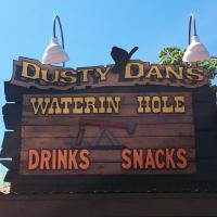 Dusty Dan's Watering Hole sign