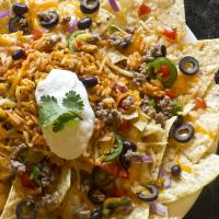 Cheese, beans, peppers, chips and beef toppings for the ultimate Macho Nacho combo.