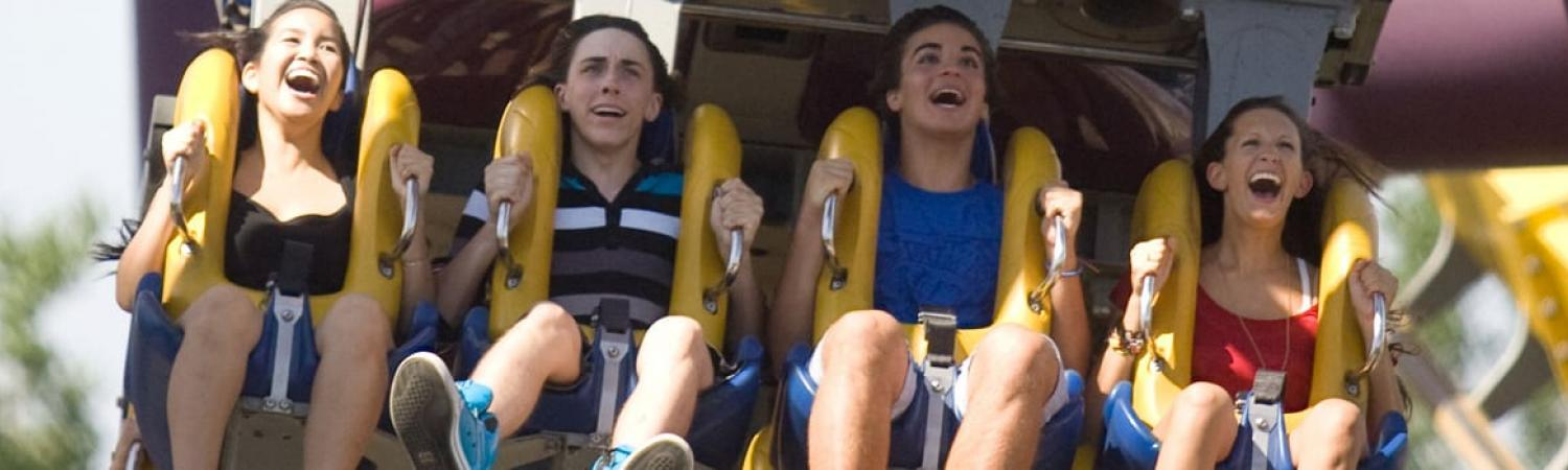 Teens enjoying a roller coaster at La Ronde