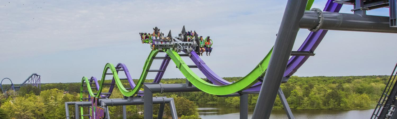 Riders on The Joker at Six Flags Adventure