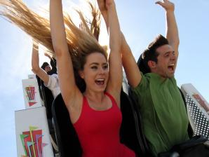 couple riding a coaster