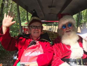 Santa and his trusted elf enjoying their summer break at The Great Escape.
