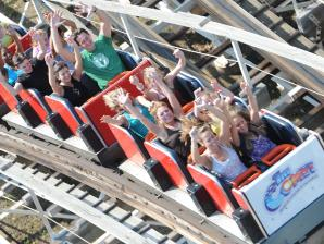 Guests riding Comet roller coaster at Six Flags Great Escape