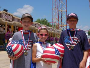Kids with patriotic gear and medals