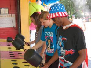 Teens  playing wack-a-mole