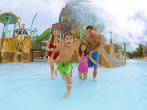 Family splashing at the park