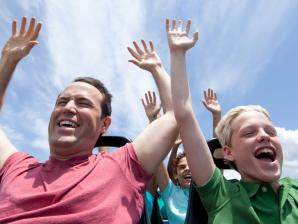 Dad and son on ride at Six Flags