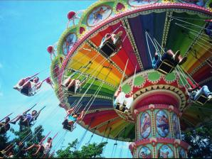 Riders on the Flying Carousel ride