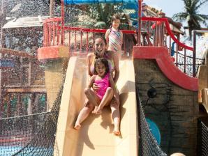 People enjoying a water slide at Hurricane Harbor.