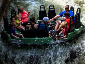 A family gets soaked on Roaring Rapids river ride
