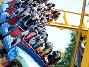 Guests riding  a roller coaster.