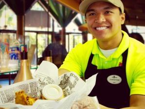 Team member serving food