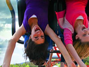 girls riding coaster